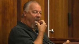 Richard Masten as he eats a piece of paper in court